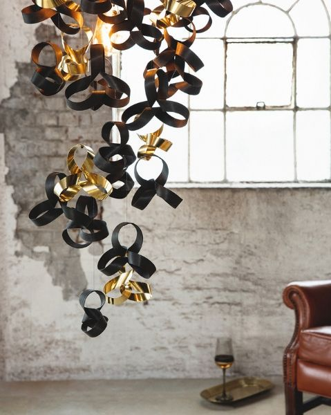 Tom Raffield Noctis Giant Flock Chandelier in an industrial setting