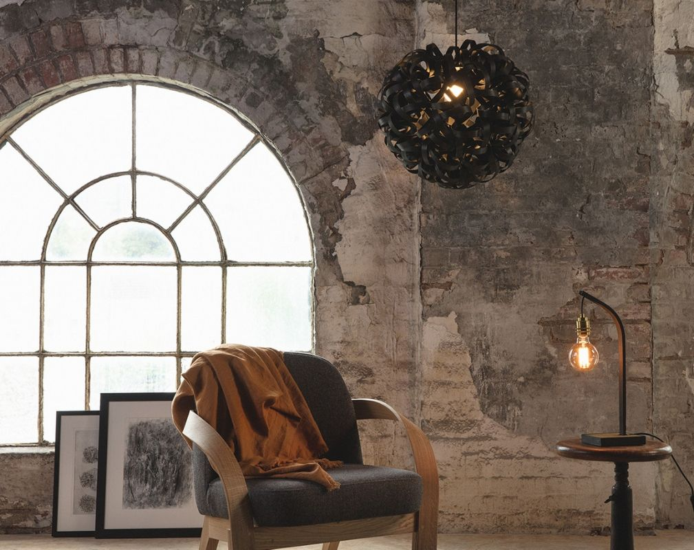 Tom Raffield Noctis No 1 Giant Pendant light set against an arched window and exposed brick wall