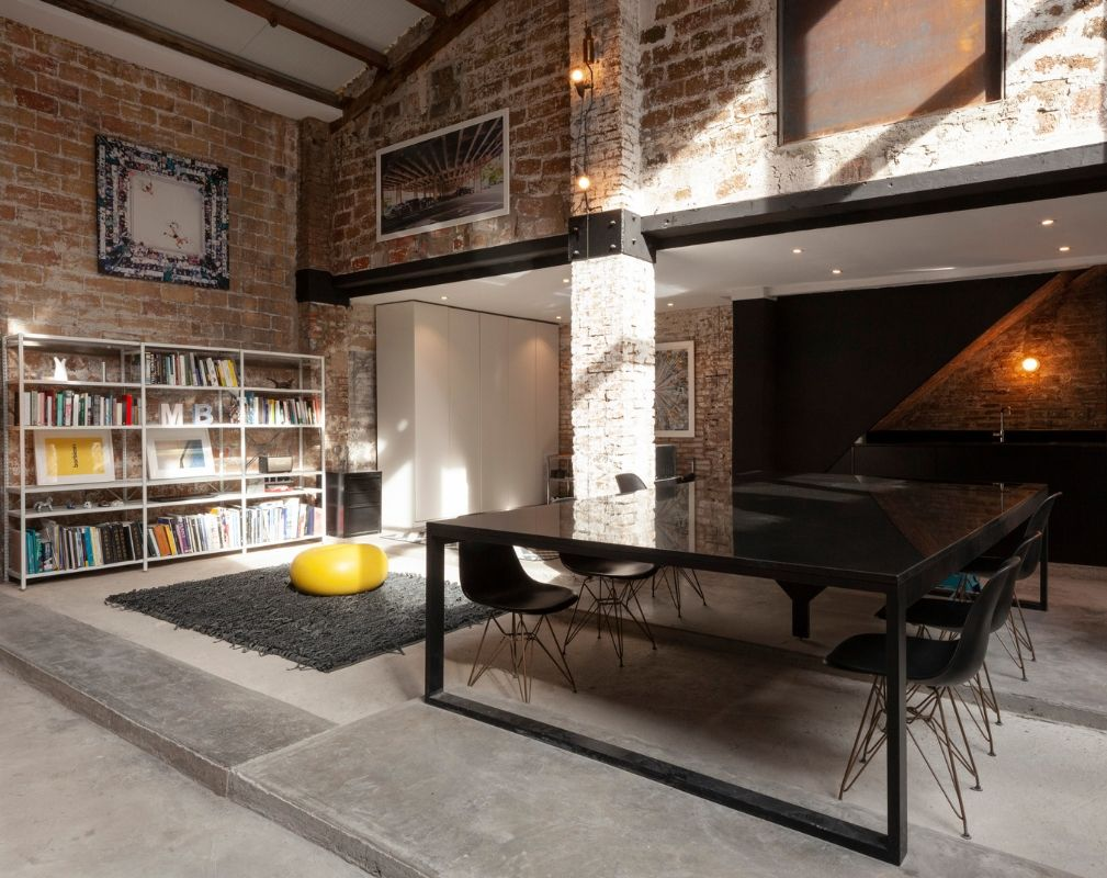 The Theatre warehouse conversion by Cadaval Sola-Morales. The living room, dining room, kitchen and study share a continuous space