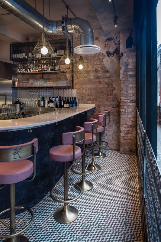 The bar at Kricket Soho designed by Run For The Hills features industrial materials