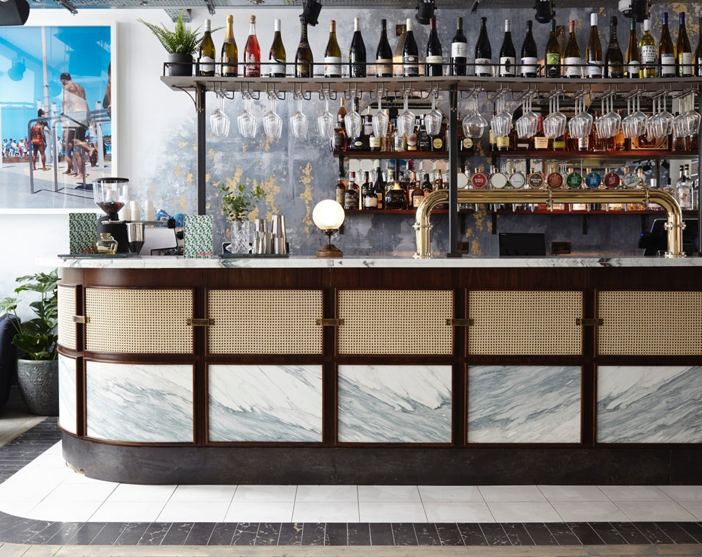 The industrial chic bar at Scarlett Green Soho in London designed by Run For The Hills