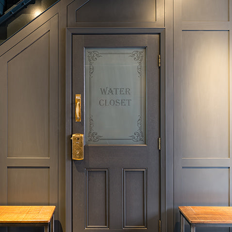 victorian water closet decal features in the bathroom of this bermondsey warehouse conversion