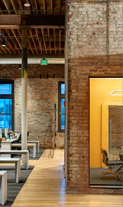 Warehouse-conversion-industrial-style-office-exposed-brick-wooden-beams-warehouse-home