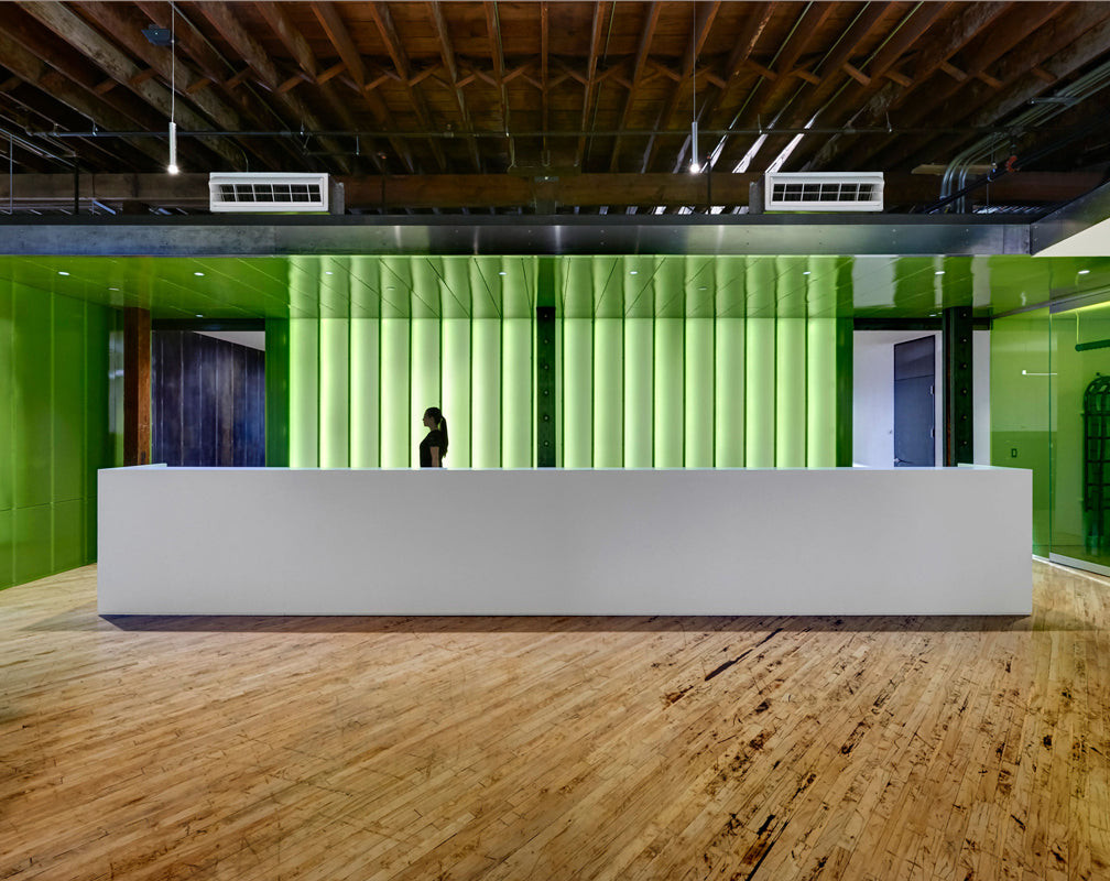 Warehouse-conversion-industrial-style-office-green-reception