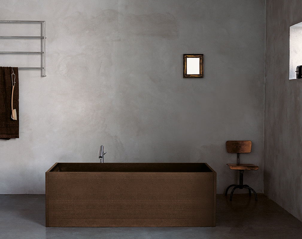 vintage industrial bathroom scheme featuring a freestanding wooden bath.