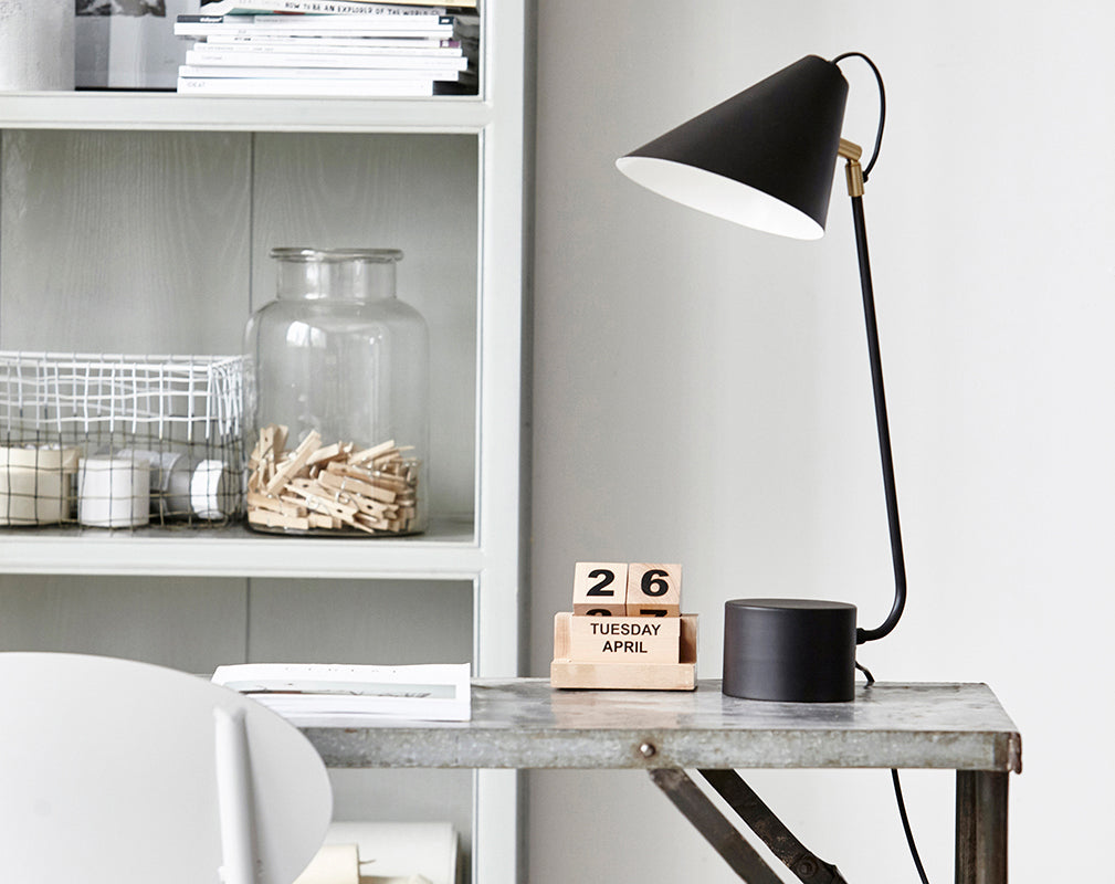 Zinc and steel trestle writing desk with matt black desk lamp.