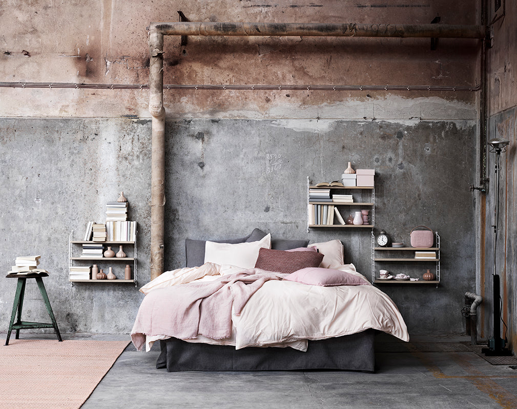 Pastel Industrial Bedroom Scheme With Exposed Pipework And Wall Mounted  String Shelving.
