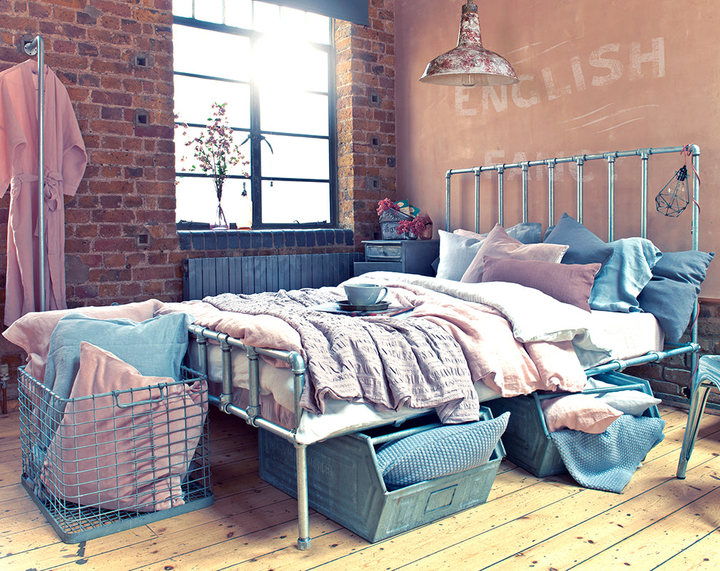 london warehouse conversion with pastel industrial bedroom scheme.