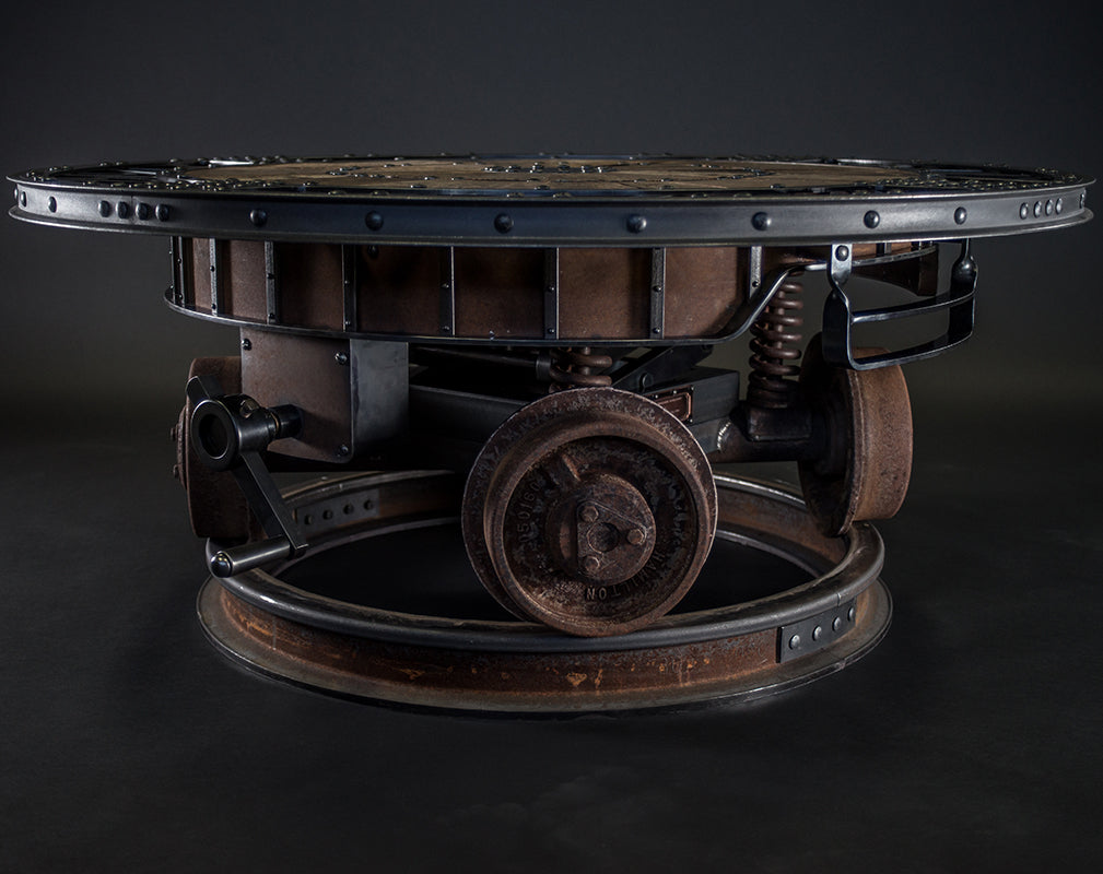 industrial revolution statement steampunk table by cory barkman.