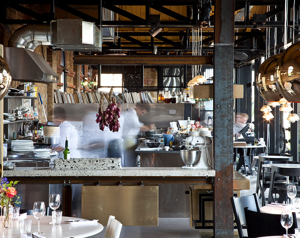 rusted steel columns feature in this restaurant interior designed by tom dixon
