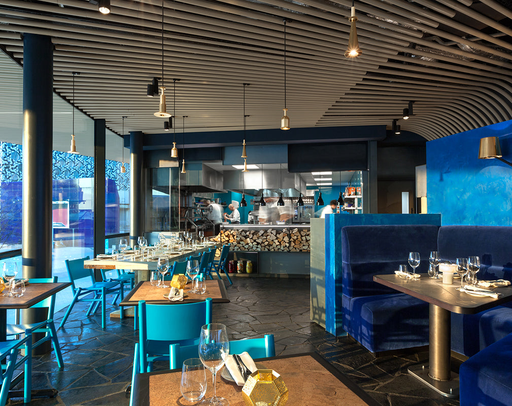 teal and blue features in the craft london restaurant interior by tom dixon