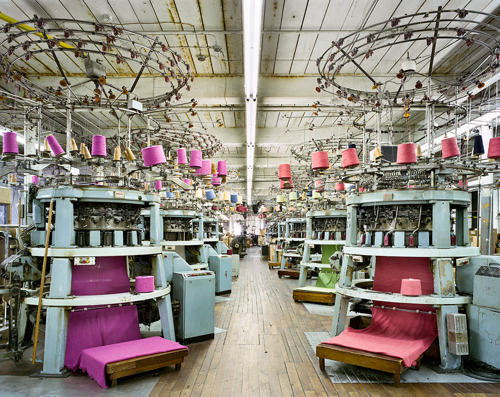 Circular knitting machines at Fall River Knitting Mills, Massachusetts. Photography by Christopher Payne.