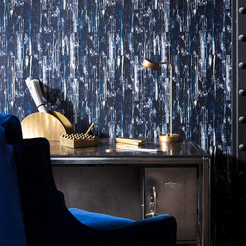 Luxe industrial home office with vintage velvet mixed metals and patinated navy wallpaper