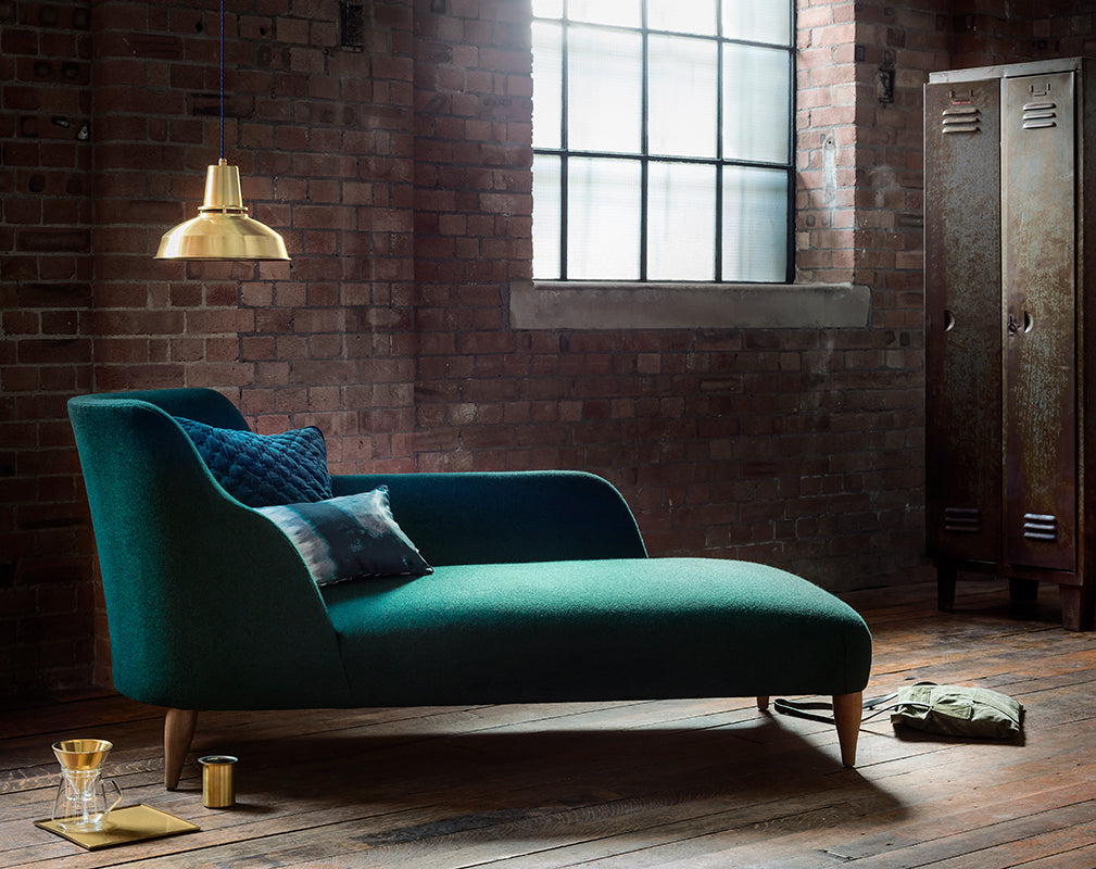 reading corner in luxe industrial interior scheme with brass factory style pendant light