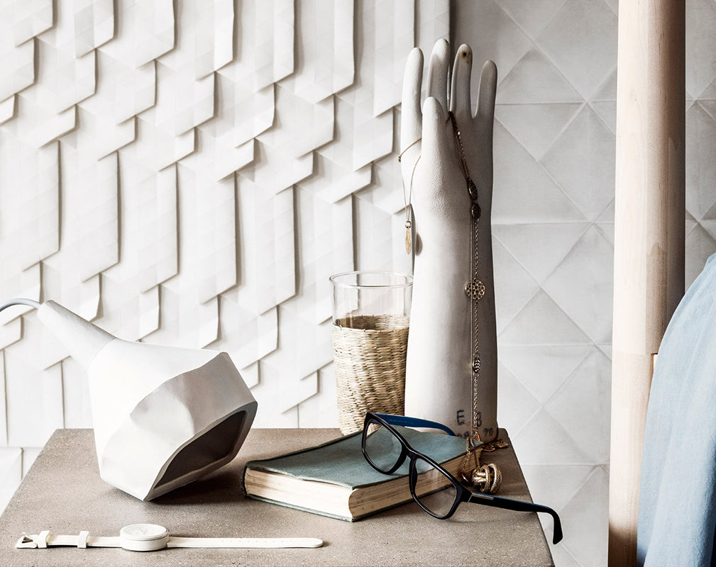 Origami wallpaper with concrete side table and accessories