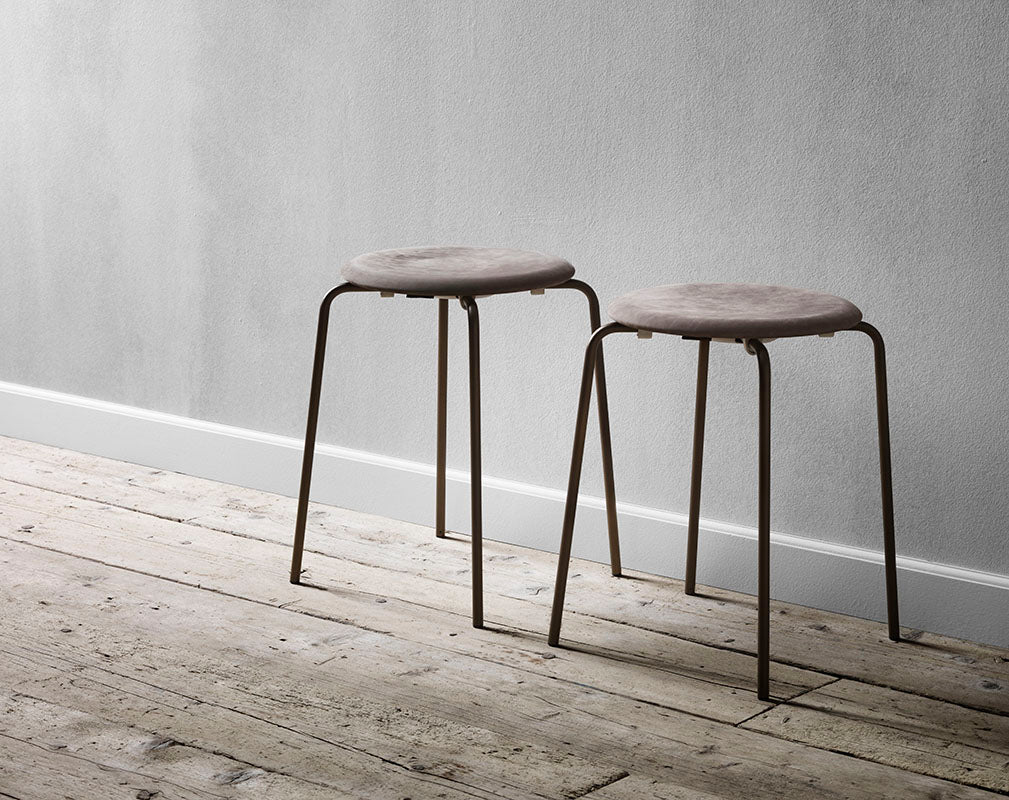 lightweight and stackable stool with leather by Arne Jaconbsen for Fritz Hansen.