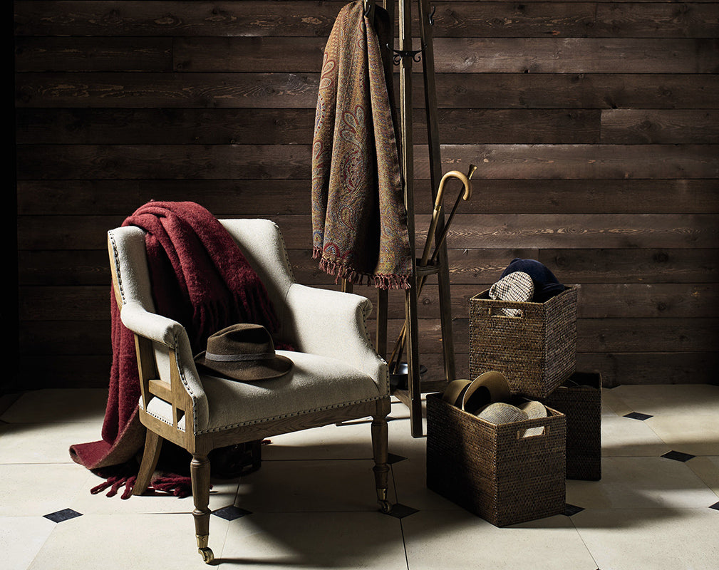 Trematon linen armchair with reclaimed timber background and vintage accessories