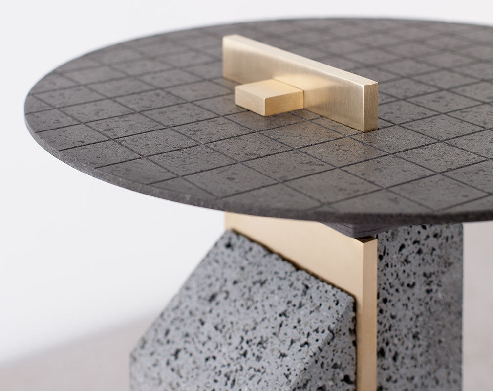 Big Pillar lava stone side table with brass detail from Formafantasma.