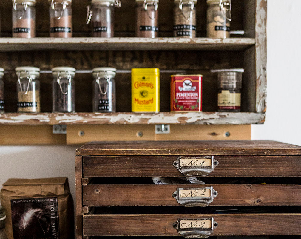 Vintage wooden drawers and spice rack.