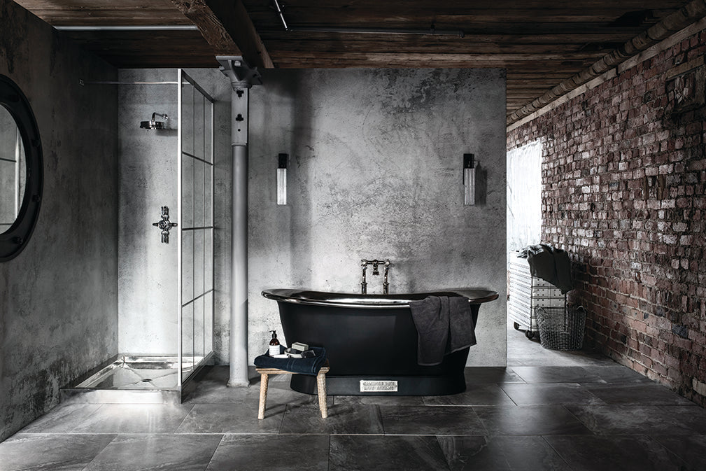 A Textured Concrete Mural Is The Perfect Backdrop To The Nickel Bathtub.  The Bespoke Shower Screen References Warehouse Windows.