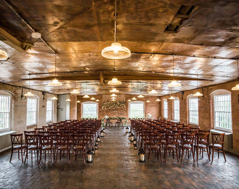 Impressive warehouse wedding venue styled by Artifact Lighting.