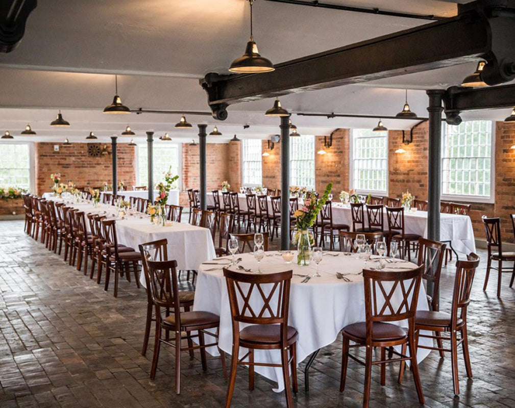 Impressive warehouse wedding venue styled by Artifact Lighting