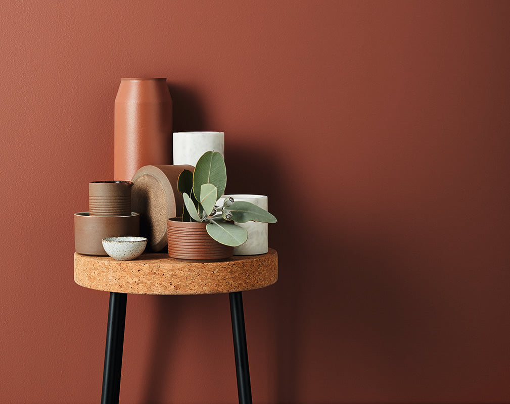 Assorted marble and terracotta vessels on cork stool by Lightly.