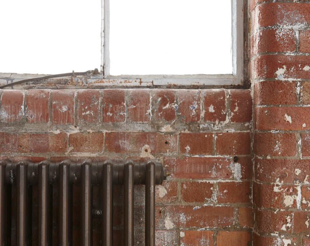 exposed brickwork and warehouse windows