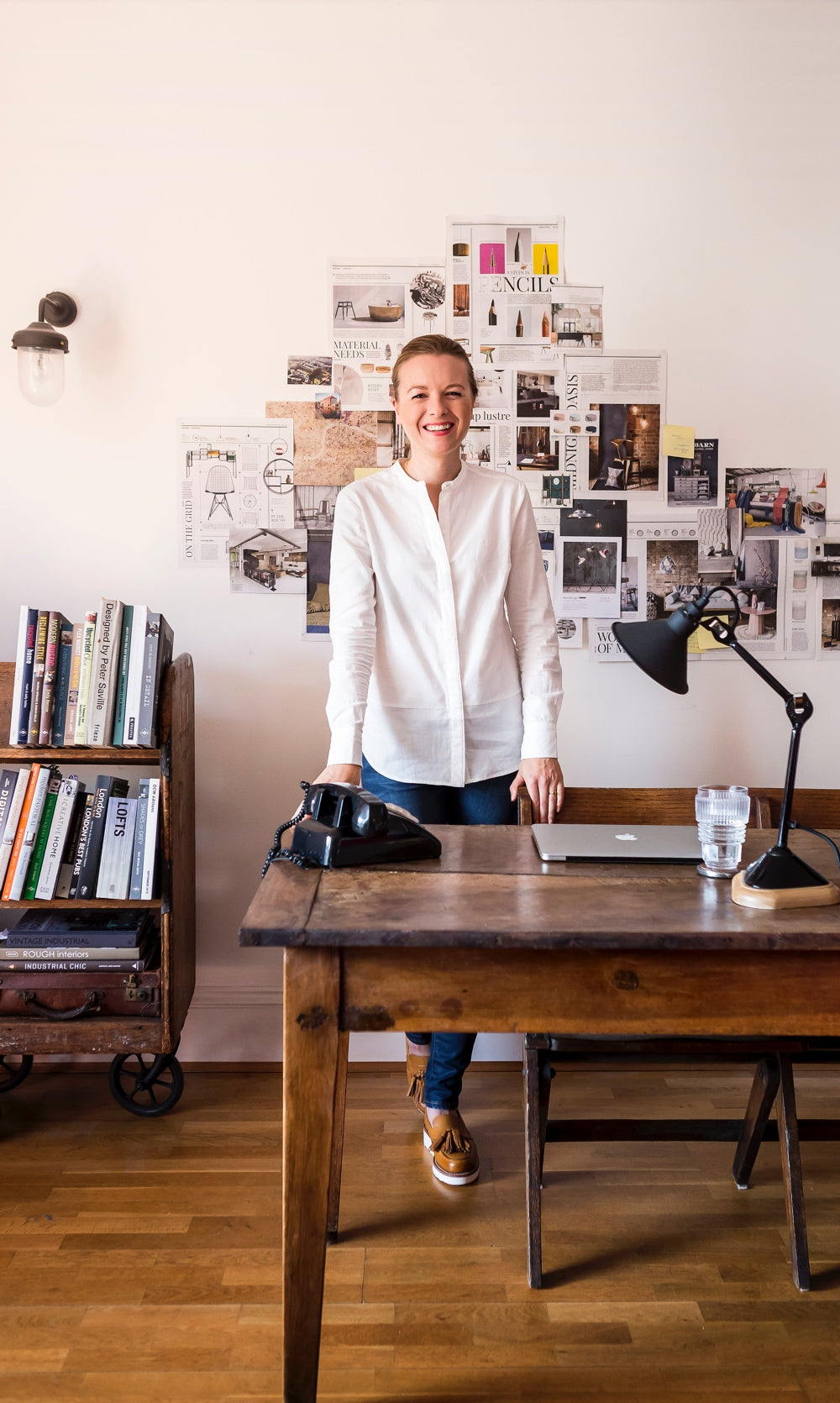 Warehouse Home founder Sophie Bush is photographed in her industrial chic dining room