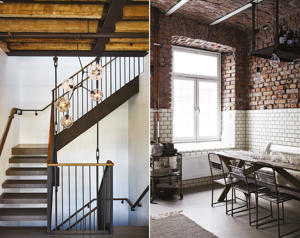 staircase with exposed beams in a warehouse conversion; vaulted brick ceiling and wall