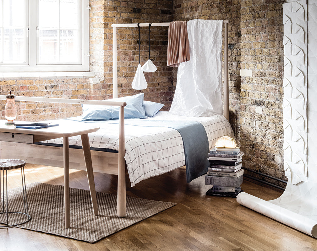 soft industrial bedroom within a london warehouse conversion