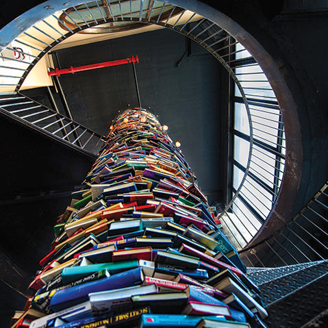 book-tower-set-within-a-steel-spiral-staircase-inside-the-paper-factory-hotel-in-williamsburg-new-york