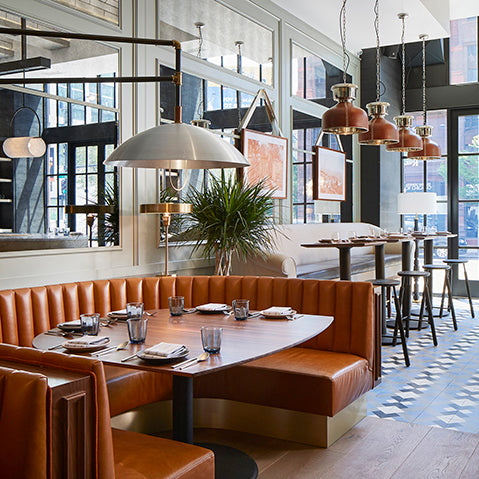 stylish pendant lights and a leather banquette feature in the proxi hotel chicago photography by david burke