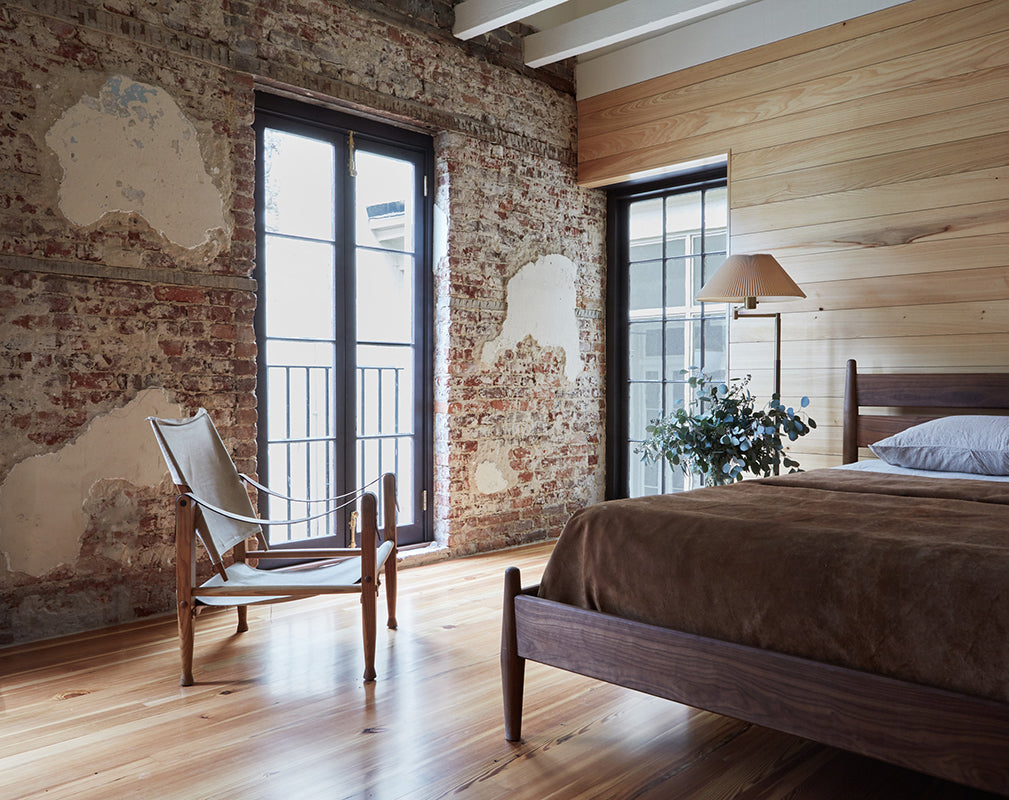 original brickwork and raw plaster becomes a feature in this converted carriage house
