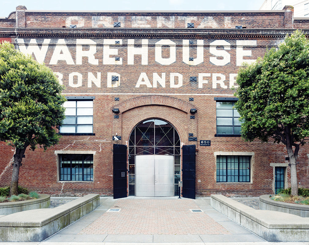 exterior of the oriental warehouse, san francisco featuring original brickwork and ghostsigns.
