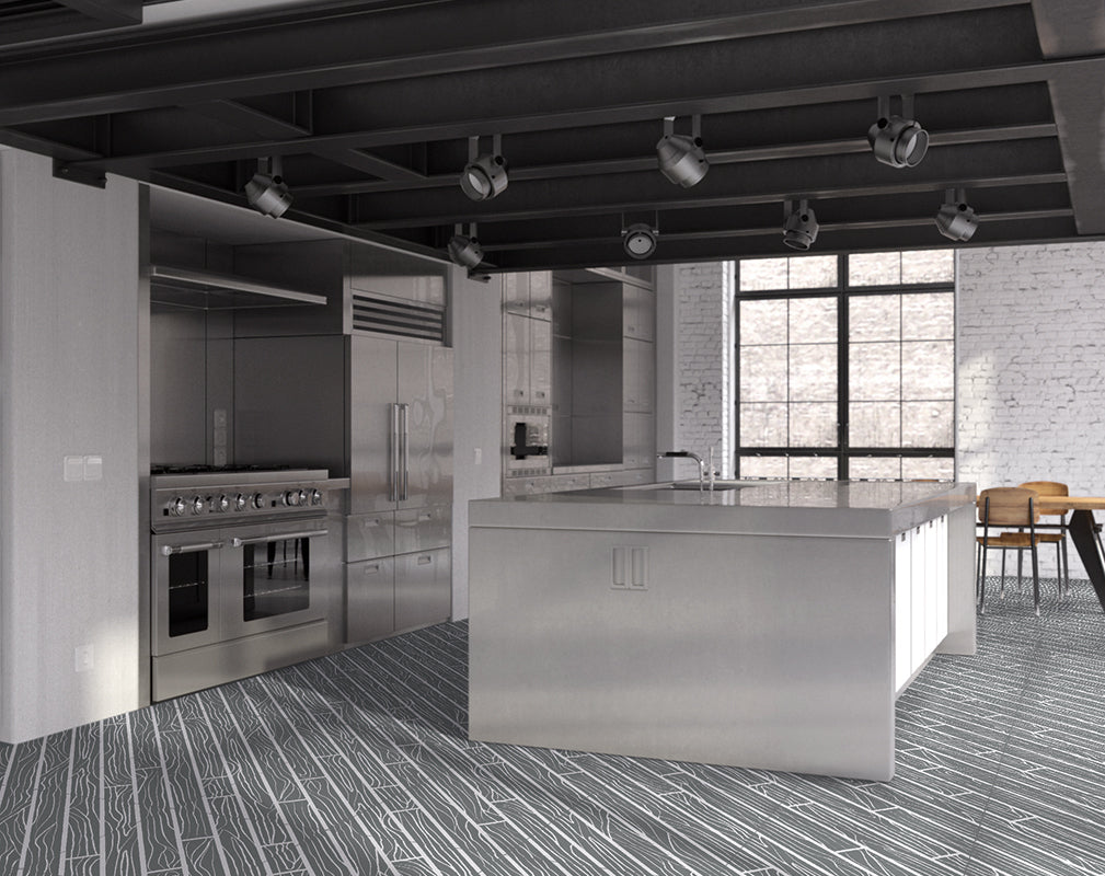 graphic wood grain floor tiles feature in this kitchen in a converted industrial building