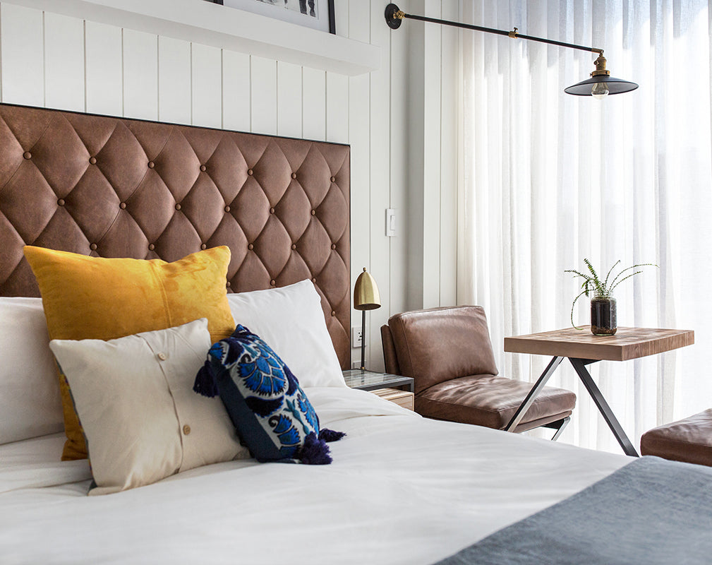 guest bedroom at the williamsburg hotel brooklyn new york features buttoned leather upholstery