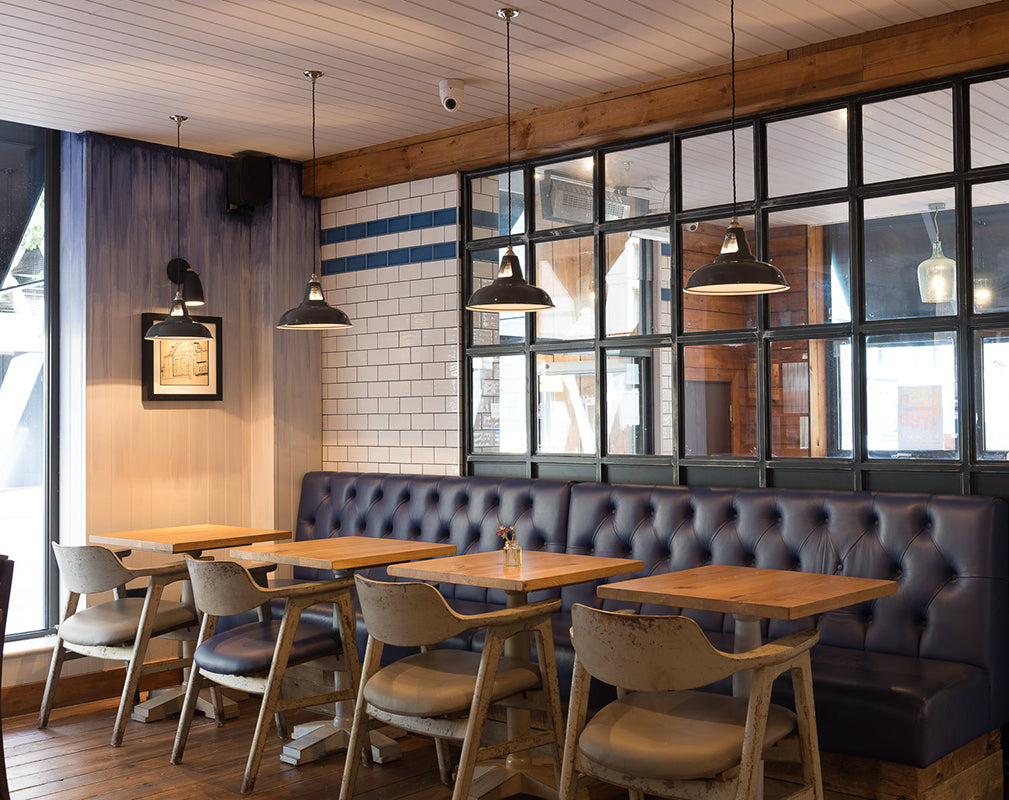 industrial restaurant interior scheme with factory style pendants from artifact lighting