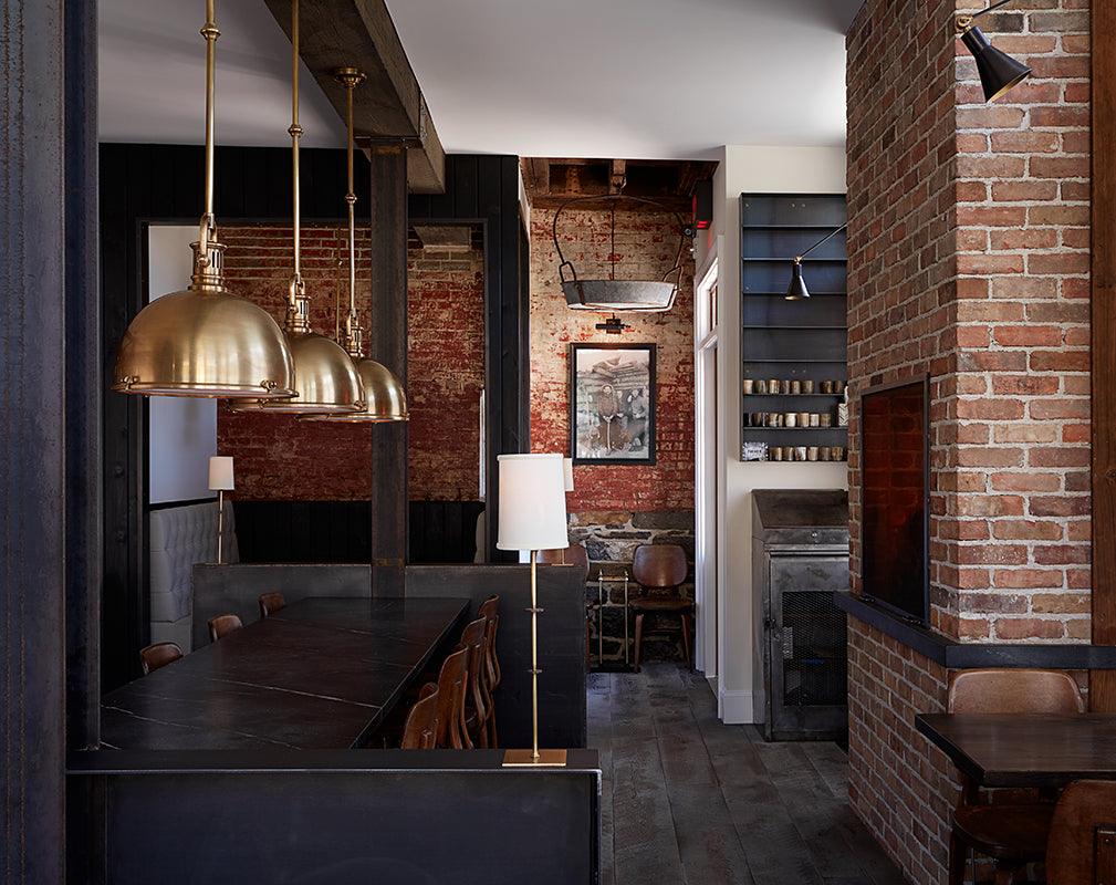 exposed brick walls and sturdy timber beams frame the restaurant of wm farmers and sons