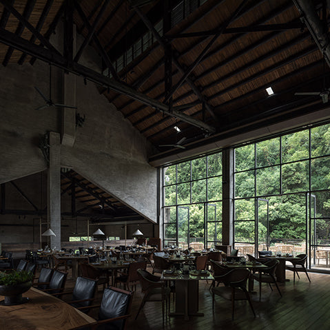 restaurant interior of alila yangshuo, china features concrete walls, steel columns and trusses photography by hao chen