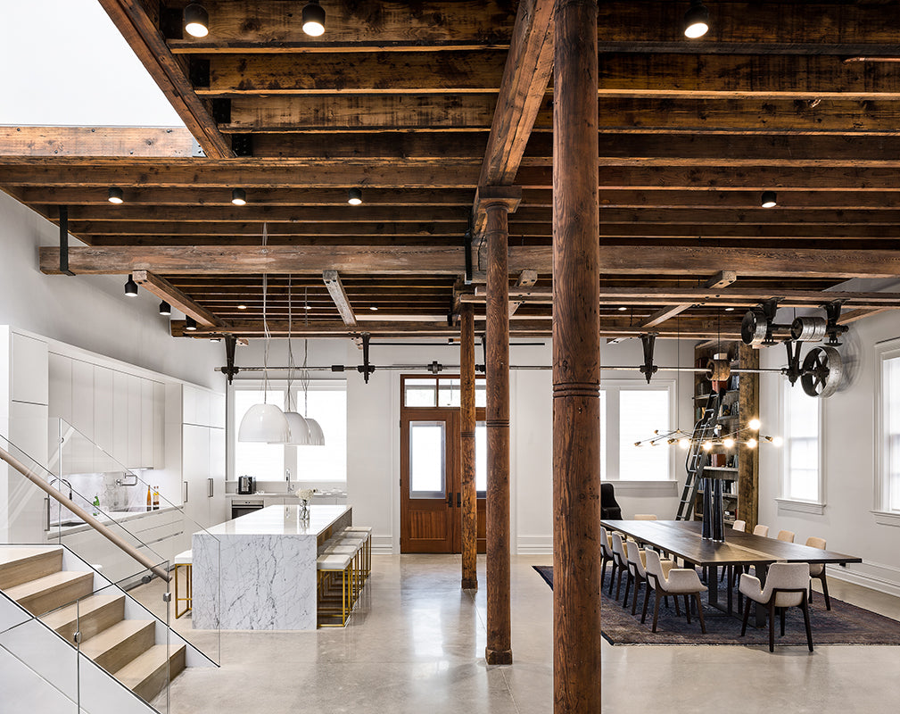 open plan living room in this new jersey warehouse conversion features exposed wooden beams and columns
