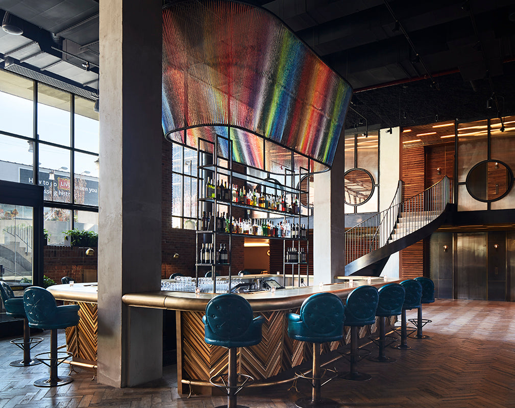 hotel bar in the williamsburg hotel booklyn features installation by local street artist