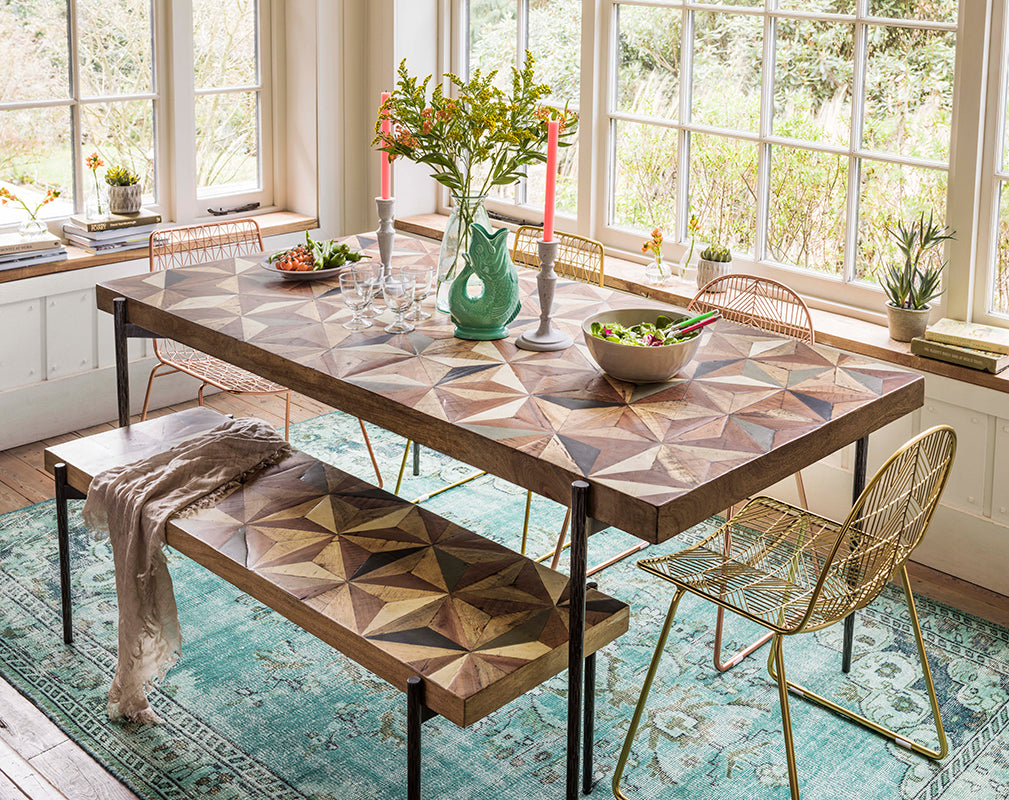 the ashton dining table and bench from graham and green features an intricate mango wood top
