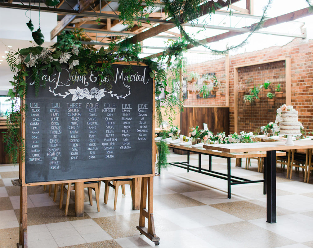 warehouse wedding venue in melbourne australia with exposed brick and hanging greenery