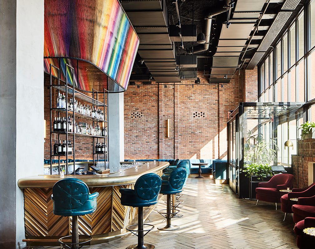 hotel bar at the williamsburg hotel brooklyn new york features exposed brick and original parquet flooring