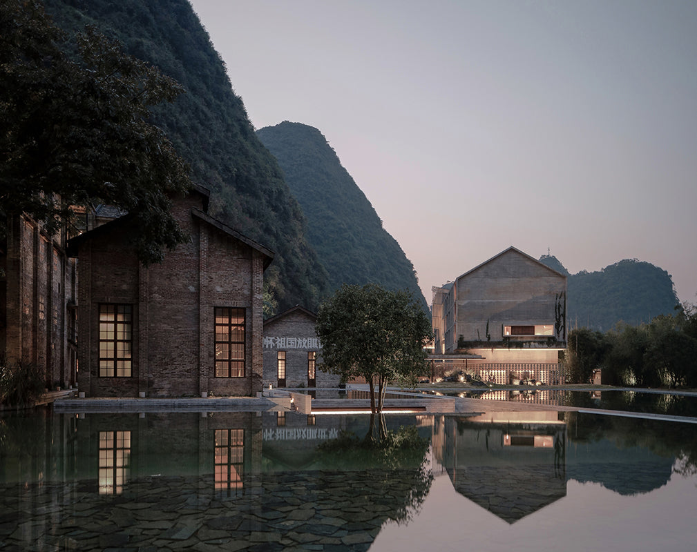 exterior of alila yangshuo a converted sugar factory sits along the yulong river, china photography by Shengliang  Su