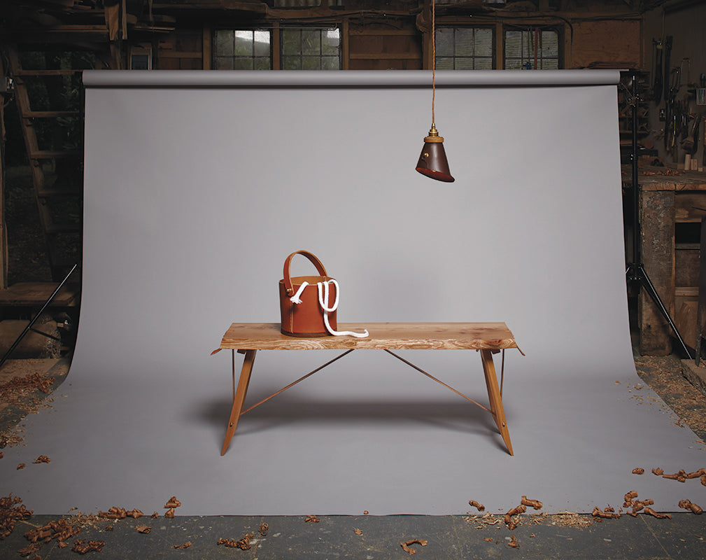 original british hardwood is handcrafted into beautiful live edge furniture shown here with leather goods.