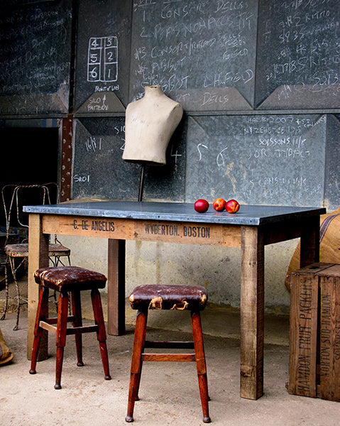 zinc topped workstation with red stools and vintage mannequin from quirky interiors