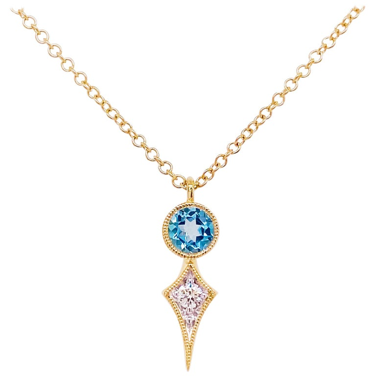Blue Topaz & Diamond Pendant Necklace in Gold