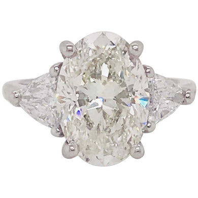 5.88 Carat Oval Diamond Three-Stone Platinum Engagement Ring Trillion Diamonds